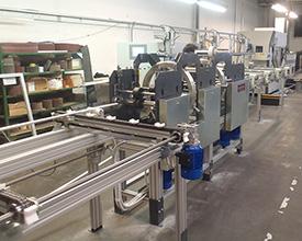 Stroj za foliranje profilov - Avtomatizacija - Robotehnika - Konstruiranje strojev in naprav